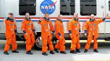 Endeavour's crew members leave their quarters at the Kennedy Space Center in Florida, April 29, 2011, shortly before the shuttle's launch was scrubbed. (Stan Honda / AFP/Getty Images)