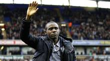 Bolton Wanderers' Fabrice Muamba reacts ahead of their English Premier League soccer match against Tottenham Hotspur at the Reebok Stadium in Bolton, northern England, May 2, 2012. (DARREN STAPLES/Reuters)