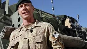Brigadier-General Daniel Menard, commander of Canada's task force Afghanistan, speaks to reporters in Kandahar on Jan. 30, 2010.
