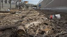 Debris left from flood waters litters a downtown sidewalk in Calgary, Alberta June 24, 2013. Most of the city's core remained deserted as workers continued to clean up from flood damage when the Bow and Elbow Rivers overflowed their banks last week. (ANDY CLARK/REUTERS)