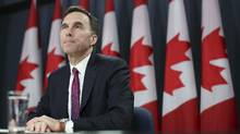 Canada's Finance Minister Bill Morneau listens to a question during a news conference upon the release of the economic and fiscal update in Ottawa on Nov. 20, 2015. Mr. Morneau said any tax changes the Canadian government makes on stock options will only take effect once the changes are made. (CHRIS WATTIE/REUTERS)