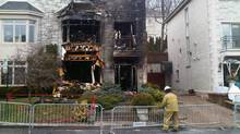 A firefighter surveys the damage Dec. 3, 2012 after a fire at the Montreal home of businessman Ari Ben-Menashe. (SEAN GORDON/THE GLOBE AND MAIL)