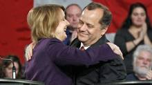 Toronto MP Peggy Nash and former party president Brian Topp embrace after the NDP leadership debate in Ottawa on Dec. 4, 2011. (BLAIR GABLE/Blair Gable/Reuters)