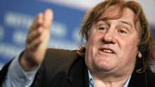 "Actor Gerard Depardieu speaks during a news conference to promote the movie ""Mammuth"" at the Berlinale International Film Festival in Berlin, February 19, 2010. (Christian Charisius/Reuters)"
