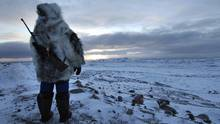 A hunter is seen on Baffin Island. Inuit in Clyde River, Nunvavut, are protesting seismic testing which they fear will disrupt the animals they rely on for food. (Fred Lum/The Globe and Mail)