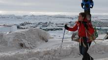Raleigh Seamster, a project lead with Google Maps, walks around Iqaluit with a camera on her back on March 19, 2013. (MICHEL ALBERT FOR THE GLOBE AND MAIL)