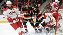 Carolina Hurricanes' Eric Staal, left, skates away as Ottawa Senators' Chris Neil and Jean-Gabriel Pageau (44) celebrate a goal by teammate Zack Smith, not shown, on Hurricanes goalie Eddie Lack (31) during second period NHL hockey action in Ottawa on Thursday, Feb. 18, 2016. (Sean Kilpatrick/THE CANADIAN PRESS)
