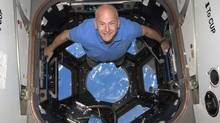 STS-131 commander Alan Poindexter poses for a photo in the Cupola of the International Space Station on April 17, 2010. (NASA files/Reuters)
