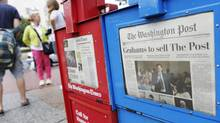 A newspaper box offers copies of the Washington Post for sale near the U.S. Capitol in Washington, August 6, 2013. Amazon.com Inc founder Jeff Bezos will buy the Washington Post newspaper for $250 million in a surprise deal that ends the Graham family's 80 years of ownership and hands one of the country's most influential publications to the businessman whose Internet company has transformed retailing. (JONATHAN ERNST/REUTERS)