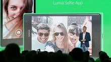 Chris Weber, CVP, Mobile Devices Sales of Microsoft, presents the new Lumia Selfie App for their smart phones during his keynote speech during a Microsoft Nokia presentation event at the consumer electronic fair IFA in Berlin, Thursday, Sept. 4, 2014. (Markus Schreiber/AP)