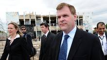 Canada's Minister of Foreign Affairs John Baird, right, and Canadian Ambassador to Libya Sandra McCardell, left, visit the former fortified compound of Moammar Gadhafi in Bab al-Azizya in Tripoli, Libya on Tuesday, October 11, 2011. (Sean Kilpatrick/THE CANADIAN PRESS)