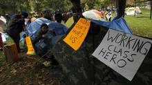 Protesters set up tents in St. James Park during Occupy Toronto protests on October 15, 2011. (Peter Power/ The Globe and Mail/Peter Power/The Globe and Mail)