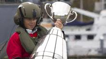 Peewee football player Dario Ciccone arrives with the Grey Cup aboard a CH-124 Sea King helicopter at HMCS Discovery in Vancouver, November 23, 2011. (John Lehmann/The Globe and Mail/John Lehmann/The Globe and Mail)