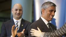 Board chair John Montalbano, left, looks on as Dr. Arvind Gupta is congratulated by his colleagues on his new position on the UBC grounds in Vancouver, British Columbia, Wednesday, March 12, 2014. (Rafal Gerszak For The Globe and Mail)