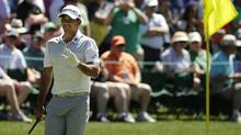 In this April 4, 2016, file photo, Jason Day, of Australia, waves to spectators on the 16th green during a practice round for the Masters golf tournament, in Augusta, Ga. (Charlie Riedel/AP)