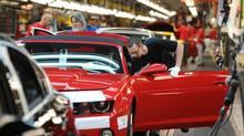 Workers on General Motors 'flex line' build automobiles in Oshawa, Ont. (Kevin Van Paassen/Staff)