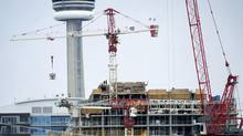 Workers are seen at a condo development in the Liberty Villiage area in Toronto. (Kevin Van Paassen/The Globe and Mail)