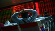 Chinese equities led another day of volatility across Asia on January 8 as investors were panicked by Beijing's attempts to stabilise its beleaguered markets, with fears growing the global economy could be teetering. (WANG ZHAO/AFP/Getty Images)