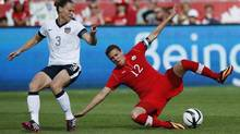 Christine Sinclair (R) of Canada battles for the ball with Christie Rampone of the U.S. during the second half of their friendly women's soccer match in Toronto, June 2, 2013. (MARK BLINCH/REUTERS)