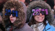 Revellers celebrate New Year's Eve in Times Square in New York December 31, 2010. (LUCAS JACKSON/REUTERS/Lucas Jackson)