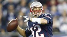 New England Patriots quarterback Tom Brady (12) passes the ball against the New Orleans Saints during the second half at Gillette Stadium. (Mark L. Baer/USA Today Sports)