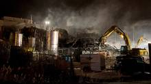 Smoke billows from the Neptune Technologies & Bioressources plant in Sherbrooke, Que., Thursday, November 8, 2012 following a large explosion which sent a number of people to hospital with serious injuries. (Graham Hughes/The Canadian Press)