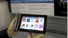 A customer looks at the BlackBerry Playbook in April, 2011. Research in Motion will report Dec. 15 on what many expect to be a grim third quarter. (Ryan Remiorz/THE CANADIAN PRESS/Ryan Remiorz/THE CANADIAN PRESS)