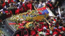 The coffin of Venezuela's late president Hugo Chavez is driven through the streets of Caracas after leaving the military hospital where he died of cancer. (STRINGER/VENEZUELA/REUTERS)