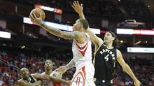 Houston Rockets forward Michael Beasley (8) shoots the ball past Toronto Raptors forward Luis Scola (4) in the second quarter at Toyota Center in Houston, Texas on March 25, 2016. (Thomas Shea/USA Today Sports)