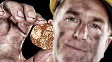 Gold miner with nugget (Joe Belanger/Getty Images/iStockphoto)