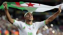 Algeria's Sofiane Feghouli celebrates after the group H World Cup soccer match between Algeria and Russia at the Arena da Baixada in Curitiba, Brazil, Thursday, June 26. (Ivan Sekretarev/The Associated Press)