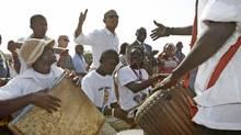 U.S. President Barack Obama meets with African drummers on Goree Island near Dakar, Senegal, June 27, 2013. Obama visited the island on Thursday where African slaves in past centuries were shipped west. (JASON REED/Reuters)