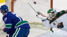 Vancouver Canucks centre Ryan Kesler (17) sends the puck past Minnesota Wild goalie Niklas Backstrom (32) for a goal during first period NHL hockey action in Vancouver Monday, March 14, 2011. THE CANADIAN PRESS/Geoff Howe (GEOFF HOWE)