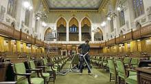House of Commons staff vacuum the Commons floor on Parliament Hill Friday, September 15, 2006. Canadians will be sending 30 more MPs to the House of Commons in the next general election scheduled for 2015. (FRED CHARTRAND/FRED CHARTRAND/THE CANADIAN PRESS)