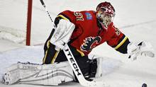 Calgary Flames goalie Curtis Joseph reaches for the puck during second period NHL Western Conference quarter-final hockey action in Calgary, Sunday, April 13, 2008. The Flames beat the Sharks 4-3 to take the lead in the best of seven series 2-1.THE CANADIAN PRESS/Jeff McIntosh (Jeff McIntosh)
