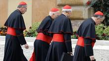 U.S. cardinals, left to right, Roger Mahoney, Francis George, Donald Wuerl and Daniel DiNardo arrive for a meeting at the Synod Hall in the Vatican on Tuesday. (STEFANO RELLANDINI/Reuters)