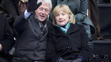 Former U.S. President Bill Clinton and wife Hillary Clinton attend New York City Mayor Bill de Blasio's inauguration at City Hall in New York Jan. 1, 2014. (CARLO ALLEGRI/REUTERS)