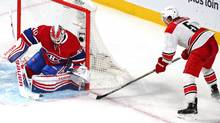 Montreal Canadiens goalie Ben Scrivens (40) makes a save against Carolina Hurricanes defenseman Noah Hanifin (5) during the third period at the Bell Centre in Montreal on Sunday, Feb. 7, 2016. (Jean-Yves Ahern/USA Today Sports)