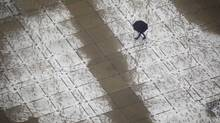 Snow covered Nathan Phillips Square on a late spring snowfall April 11, 2013. (Moe Doiron/The Globe and Mail)