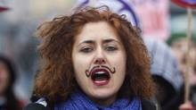 A woman shouts slogans during a demonstration to mark the International Women's Day in the Asian side of Istanbul March 6, 2010. (OSMAN ORSAL/REUTERS/OSMAN ORSAL/REUTERS)