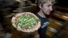 Waiter Matt Boden schleps a Libretto pizza (Peter Power/The Globe and Mail/Peter Power/The Globe and Mail)