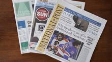 Postmedia newspapers, including the National Post and Ottawa Citizen are shown with Quebecor Media's Ottawa Sun on Oct. 6, 2014. (Justin Tang/THE CANADIAN PRESS)