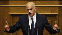 Greek Prime Minister George Papandreou delivers a speech during a parliament session on the confidence vote in Athens on November 3, 2011. (LOUISA GOULIAMAKI/AFP/Getty Images)