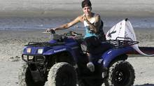 Canadian pop singer Justin Bieber drives a quad bike at the beach as he takes a break in a resort in Punta Chame on the outskirts of Panama City in a January 27, 2014