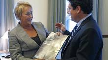 Quebecs Premier Pauline Marois speaks with Minister of Democratic Institutions Bernard Drainville during a photo-op to present the Quebec Charter of Values at the National Assembly in Quebec City on Sept. 10, 2013. (MATHIEU BELANGER/REUTERS)