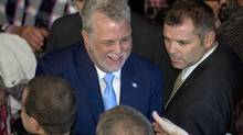 Quebec Liberal Leader Philippe Couillard is greeted by supporters following his victory speech, Monday, April 7, 2014 in St-Felicien Que. Quebecers voted for a Liberal majority government. (Jacques Boissinot/THE CANADIAN PRESS)