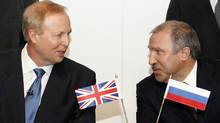 BP chief executive Bob Dudley, left, speaks with Rosneft president Eduard Khudainatov before signing an agreement at BP headquarters in London Jan. 14, 2011. (LUKE MACGREGOR/REUTERS)