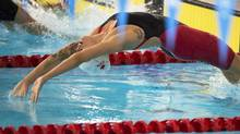 Canada's Hilary Caldwell swims to a bronze medal in the women's 200 metre backstroke final at the Tollcross Swimming Centre at the Commonwealth Games in Glasgow, Scotland on Sunday, July 27. (Andrew Vaughan/THE CANADIAN PRESS)