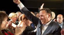 Coalition Avenir Quebec Leader Francois Legault salutes supporters at a campaign rally in Drummonville, Que., on Saturday, September 1, 2012. Quebeckers go to the polls Sept. 4, 2012 in a provincial election. (Ryan Remiorz/THE CANADIAN PRESS)