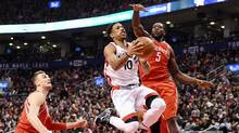 DeMar DeRozan of the Toronto Raptors soars to the net past defending Houston Rockets forward Montrezl Harrell , right, in Toronto on Sunday, Jan. 8, 2016 at the ACC. (Frank Gunn/THE CANADIAN PRESS)